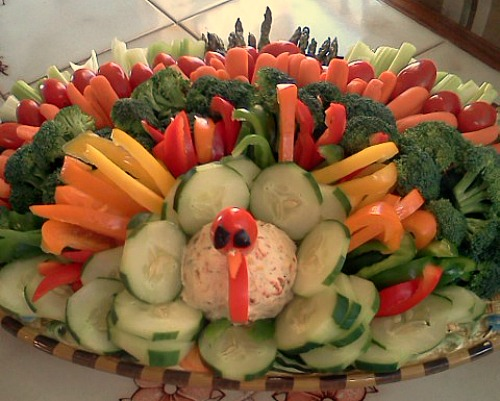 Chocolate Turkey Fondue– How cute is this fruit tray for Thanksgiving? I love that the fruit slices can be dipped into fondue! A Tasty Fruit Thanksgiving Turkey– Using a variety of colored fruits make the perfect turkey tail and the perfect Thanksgiving appetizers.