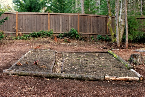 raised garden bed with logs