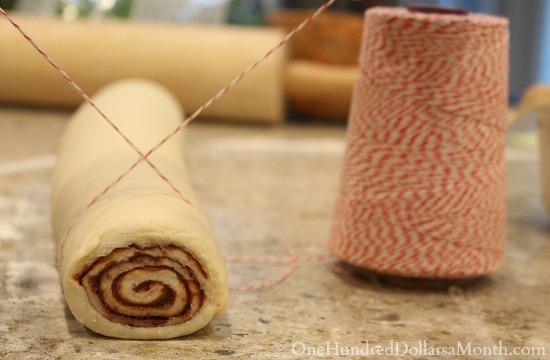 cutting cinnamon rolls